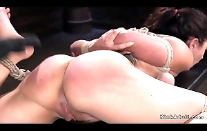 Hogtied brunette gets hot ass spanked