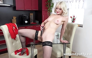 Sexy blonde in nylons pleases herself with dildo