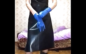 Guy in leather apron putting on another gloves